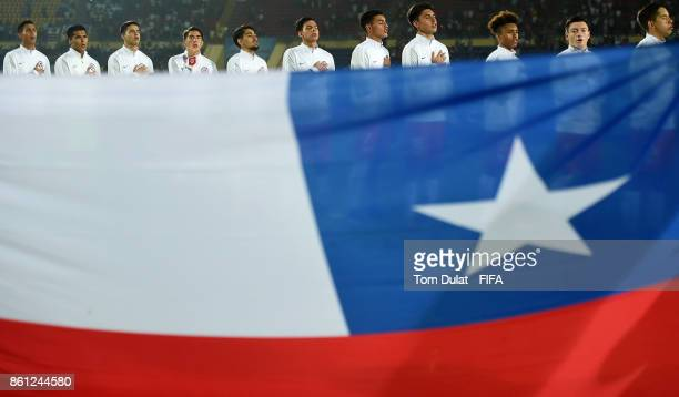 Players of hile sing their national anthem during the FIFA U17 World Cup India 2017 group E match between Mexico and Chile at Indira Gandhi Athletic...