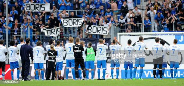 A players of Hoffenheim are pictured with a shirt of Boris Vukcevic after the Bundesliga match between TSG 1899 Hoffenheim and FC Augsburg at...