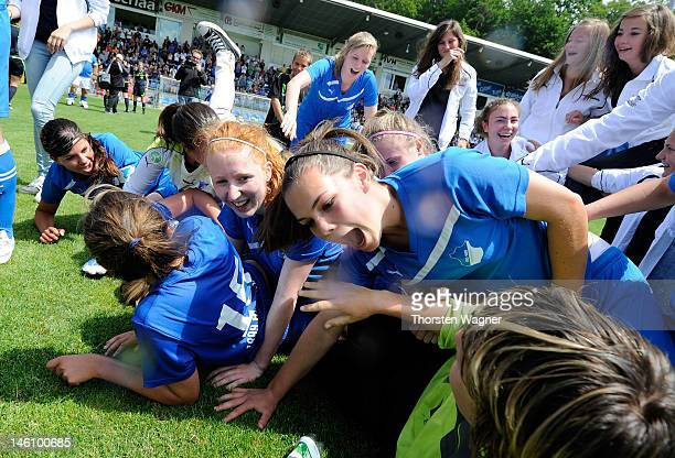 Players of Hoffenheim celebrates after winning the women's bjuniors bundesliga final match between TSG 1899 Hoffenheim and Turbine Potsdam at Dietmar...