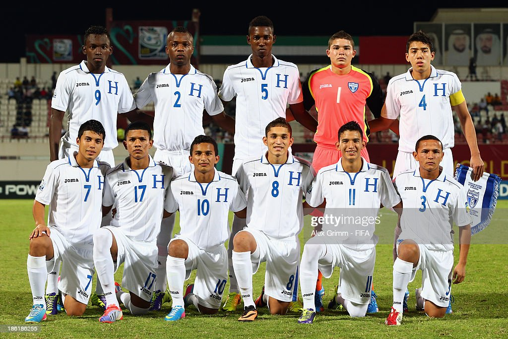 Players of Honduras pose for a team photo prior to the FIFA U-17 World Cup UAE 2013 Round of 16 match between Honduras and Uzbekistan at Sharjah Stadium on October 28, 2013 in Sharjah, United Arab Emirates.