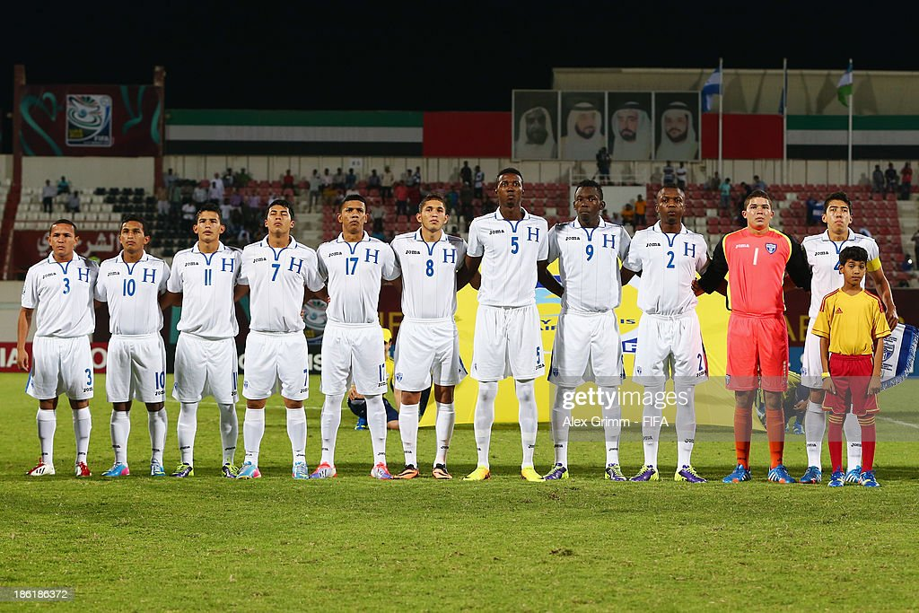 Players of Honduras sing their national anthem prior to the FIFA U-17 World Cup UAE 2013 Round of 16 match between Honduras and Uzbekistan at Sharjah Stadium on October 28, 2013 in Sharjah, United Arab Emirates.