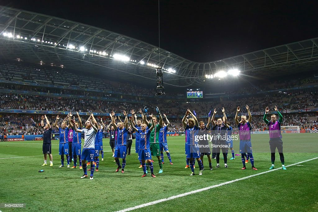 Players of Iceland celebrate at the end of the match during the European Championship match Round of 16 between England and Iceland at Allianz Riviera Stadium on June 27, 2016 in Nice, France.