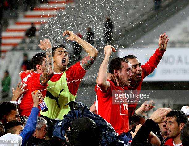 Players of Independiente celebrate being promoted to first division after one year of playing in Primera B Nacional after winning a tiebreaker match...