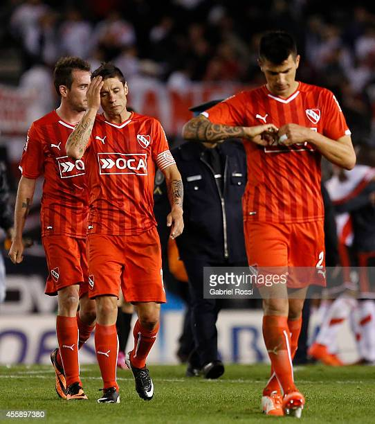 Players of Independiente leave the at the end of the match between River Plate and Independiente as part of ninth round of Torneo de Transicion 2014...