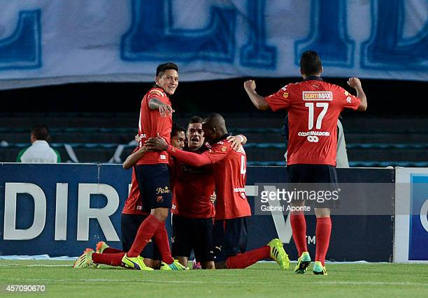 Players of Independiente Medellin celebrate a goal during a match between Millonarios and Independiente Medellin as part of Liga Postobon 2014 II at...