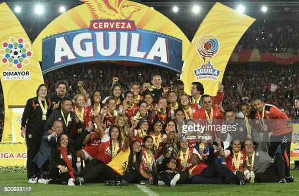 Players of Independiente Santa Fe celebrate after winning a second leg match between Independiente Santa Fe and Atletico Huila as part of Liga Águila...