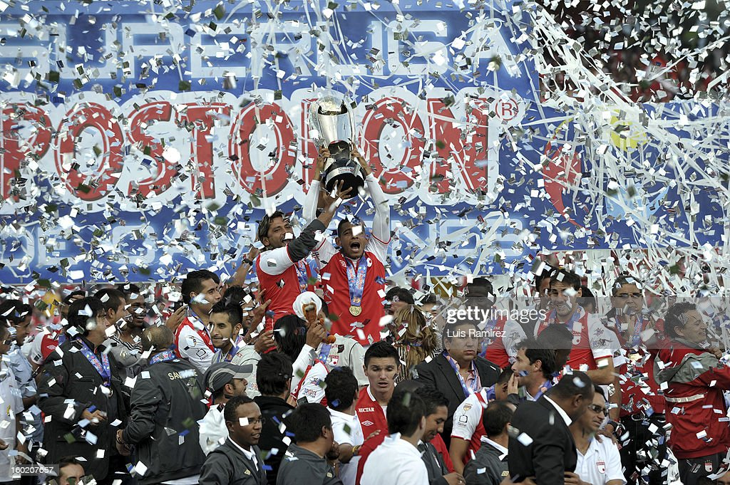 "Players of Independiente Santa Fe celebrate after winning the final match against Millonarios for the final of the Champions Super League at the Nemesio Camacho ""El Campin"" stadium in Bogota city, on January 27, 2013"