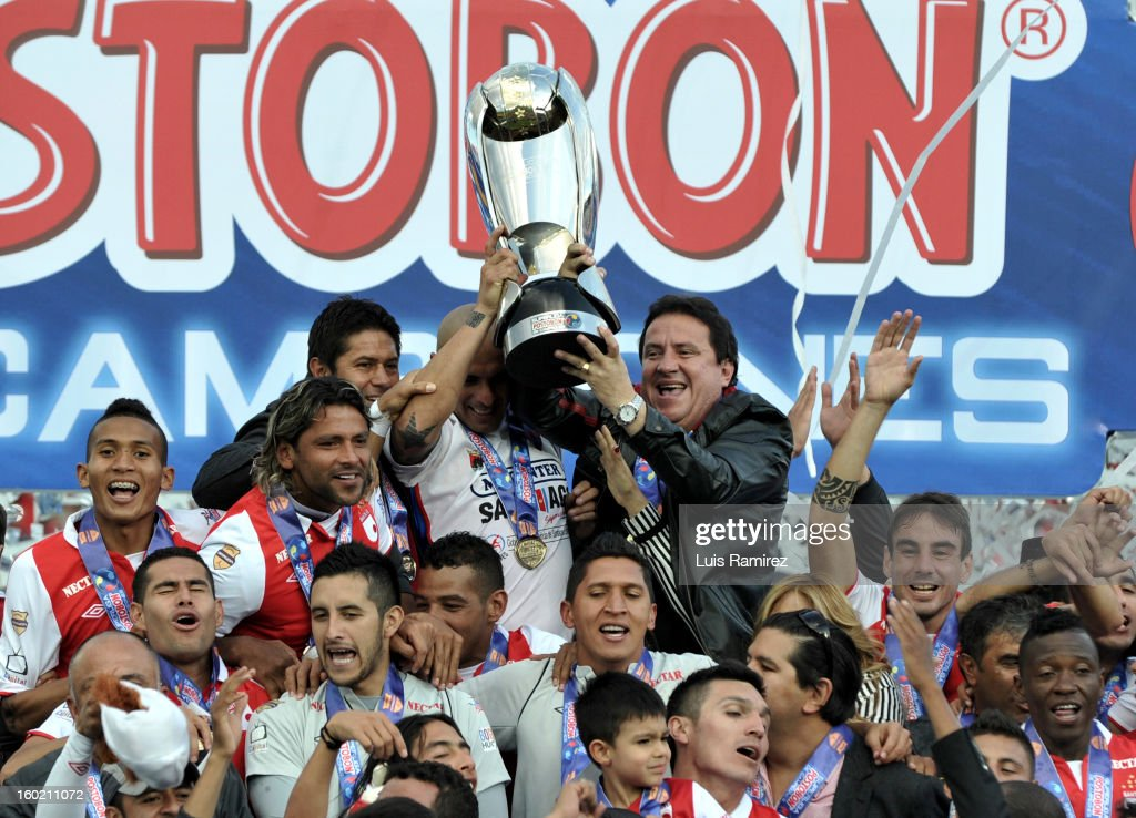 "Players of Independiente Santa Fe celebrate after winning the final match against Millonarios as part of the the Champions Super League at Nemesio Camacho ""El Campin"" stadium on January 27, 2013 in Bogota, Colombia."