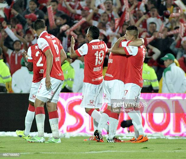 Players of Independiente Santa Fe celebrate the first goal of his team scored by Luis Arias Cardona during a second leg final match between...