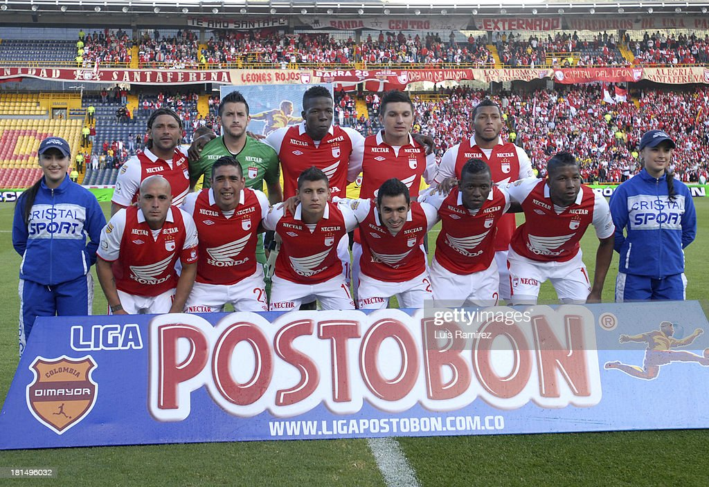 Players of Independiente Santa Fe pose before a match between Independiente Santa Fe and Millonarios as part of the Liga Postobon II at Nemesio Camacho Stadium on September 21, 2013 in Bogota, Colombia.