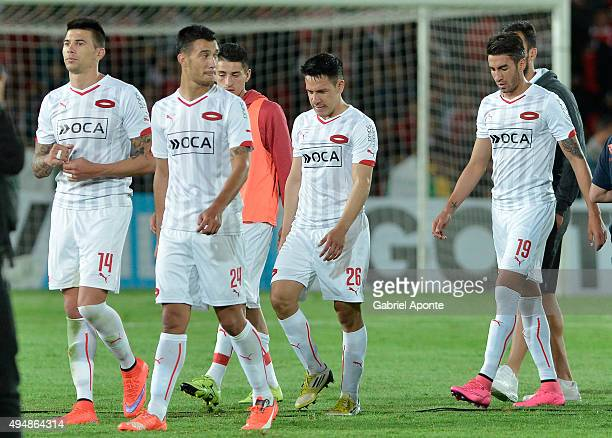 Players of Independiente walk off the field after a second leg Quarter Final match between Independiente Santa Fe and Independiente as part of Copa...