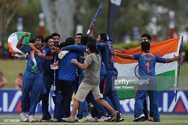 Players of India celebrate victory after the 2012 ICC U19 Cricket World Cup Final between Australia and India at Tony Ireland Stadium on August 26...