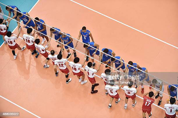Players of Italy and Japan shake hands before the match during the FIVB Men's Volleyball World Cup Japan 2015 at the Hiroshima Green Arena on...