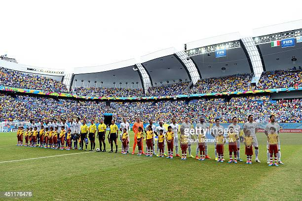 Players of Italy and Uruguay line up prior to the 2014 FIFA World Cup Brazil Group D match between Italy and Uruguay at Estadio das Dunas on June 24...