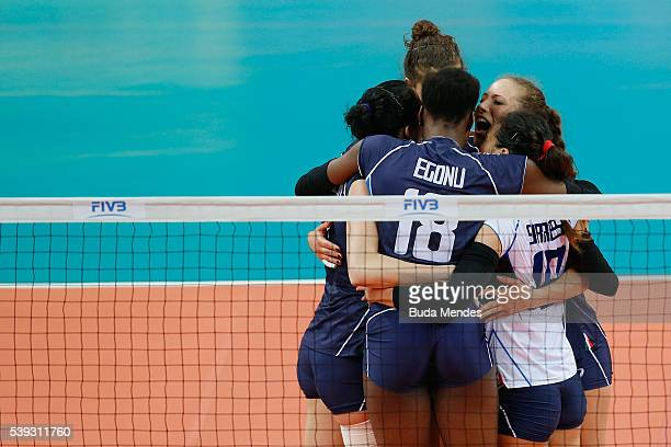 Players of Italy celebrate a point during the match against Serbia on day 2 the FIVB Volleyball World Grand Prix at Carioca Arena 1 on June 10 2016...