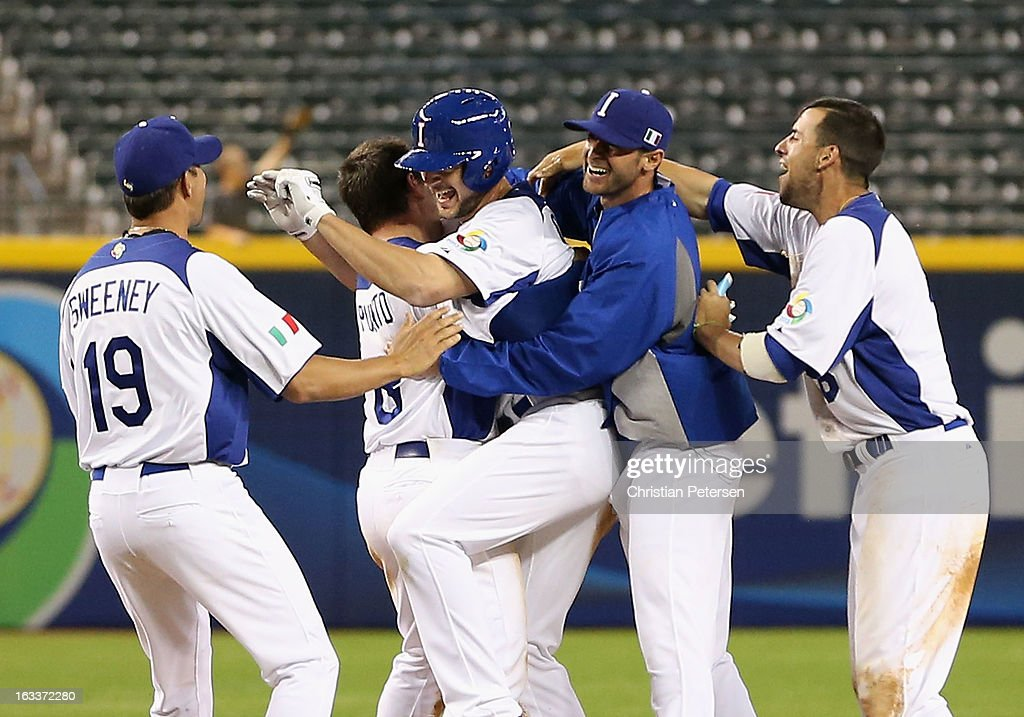 Players of Italy celebrate around Mario Chiarini #45 (C) after he had the game winning RBI single against Canada during the eighth inning of the World Baseball Classic First Round Group D game at Chase Field on March 8, 2013 in Phoenix, Arizona. Italy defeated Canada 14-4 by mercy rule in eight innings.