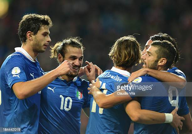 Players of Italy celebrate during the FIFA 2014 world cup qualifier between Denmark and Italy on October 11 2013 in Copenhagen Denmark