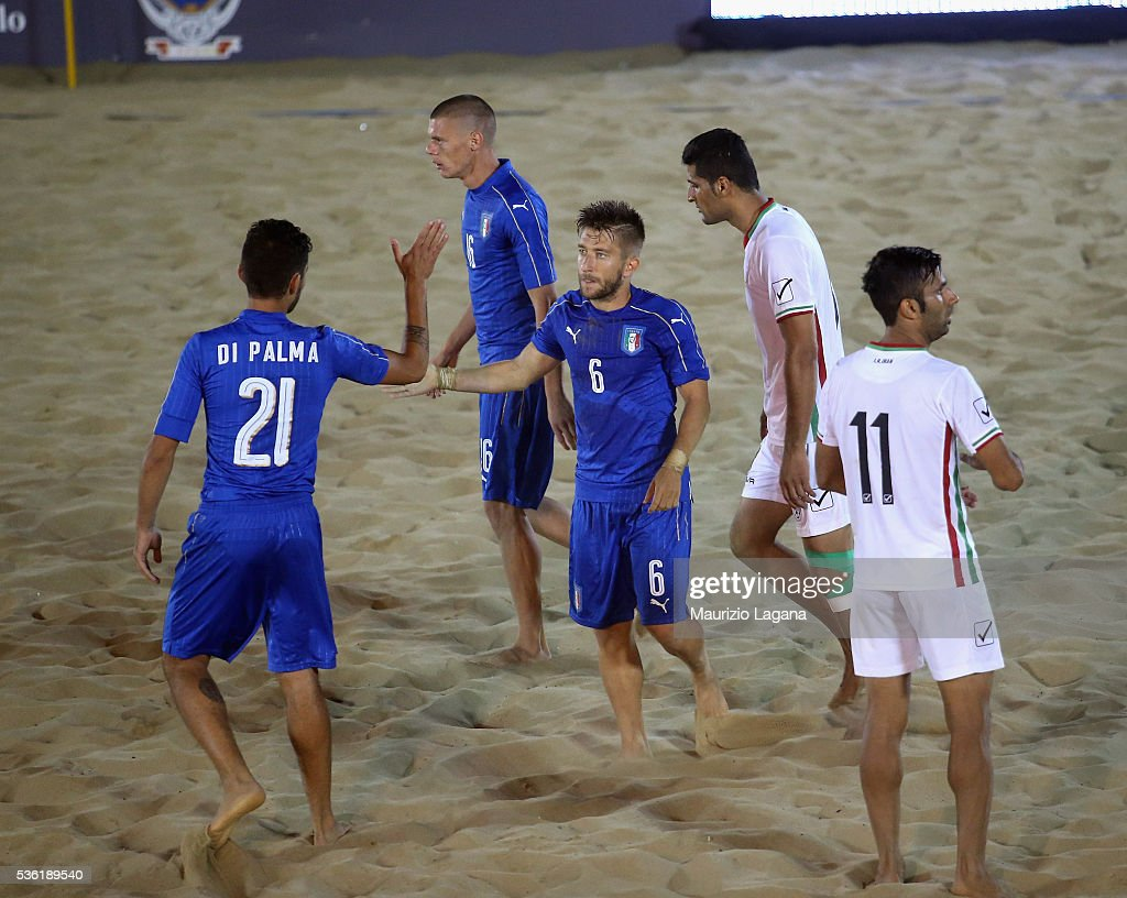 Players of Italy celebrates during the beach soccer international frienldy between Italy and Iran on May 31, 2016 in Catania, Italy.