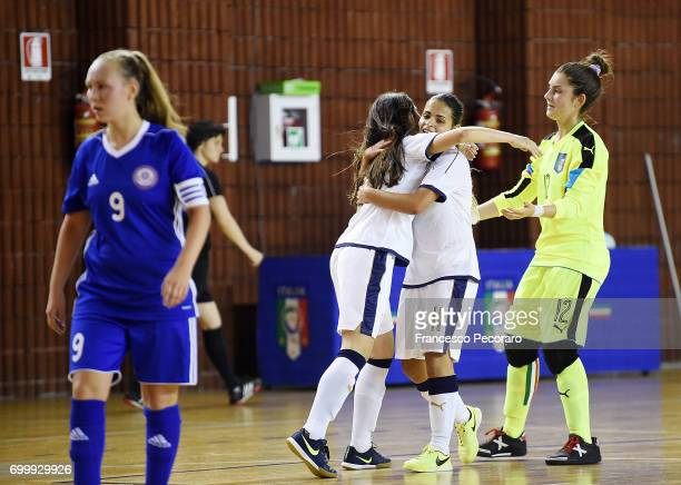 Players of Italy Laura Li Noce and Giorgia Vianale celebrate after Laura Li Noce scored the 20 goal beside the disappointment of Dana Almasbay player...