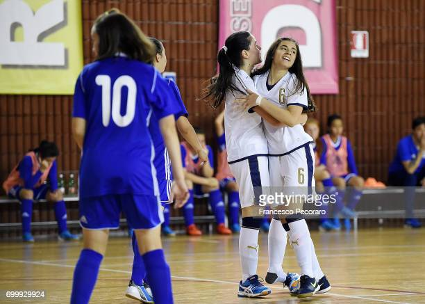 Players of Italy Lisa Molon and Laura Li Noce celebrate after scoring the 20 goal beside the disappointment of Zhansulu Khamze player of Kazakhstan...