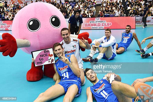 Players of Italy pose after winning the match against Japan during the FIVB Men's Volleyball World Cup Japan 2015 at the Hiroshima Green Arena on...