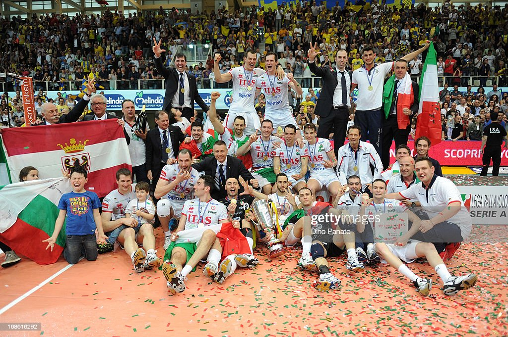 Players of Itas Diatec Trentino celebrate victory during the cup presentation ceremony after game 5 of Playoffs Finals between Itas Diatec Trentino and Copra Elior Piacenza at PalaTrento on May 12, 2013 in Trento, Italy.