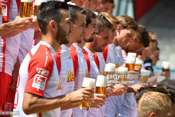 Players of Jahn Regensburg pose with a glass of beer during the team presentation at Continental Arena on July 18 2017 in Regensburg Germany