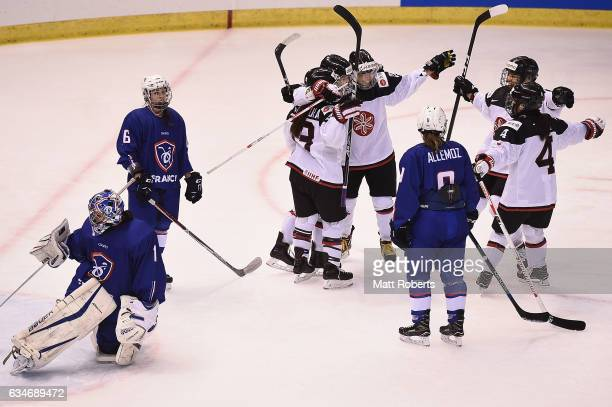 Players of Japan celebrate a goal during the Women's Ice Hockey Olympic Qualification Final game between Japan and France at Hakucho Arena on...