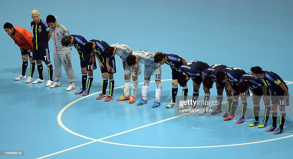 Players of Japan celebrate after winning the FIFA Futsal World Cup Group C match between Japan and Libya at Indoor Stadium Huamark on November 7, 2012 in Bangkok, Thailand.