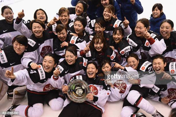 Players of Japan celebrate after winning the Women's Ice Hockey Olympic Qualification Final game between Japan and Germany at Hakucho Arena on...