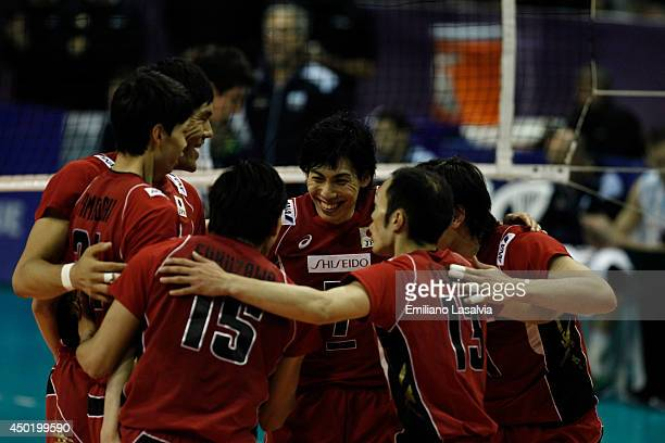 Players of Japan celebrate during a match between Argentina and Japan as part of FIVB Volleyball World League 2014 at Lomas de Zamora Microstadium on...