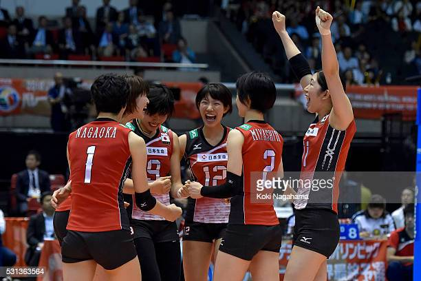 Players of Japan celebrate for apoint during the Women's World Olympic Qualification game between Japan and Peru at Tokyo Metropolitan Gymnasium on...