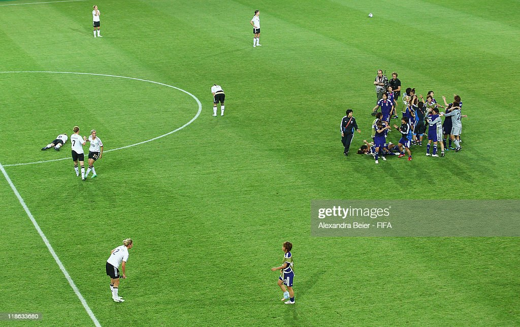 Players of Japan (R) celebrate their victory while players of Germany react after the FIFA Women's World Cup quarter finals match between Germany and Japan on July 9, 2011 in Wolfsburg, Germany.