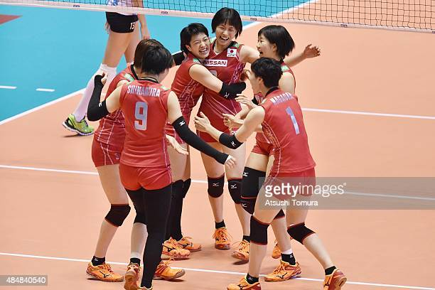 Players of Japan celebrates after a point in the match between Argentina and Japan during the FIVB Women's Volleyball World Cup Japan 2015 at Yoyogi...