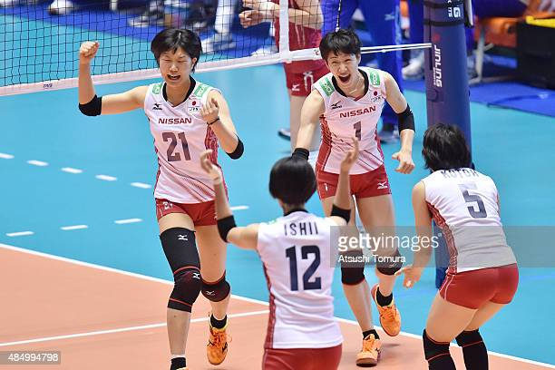 Players of Japan celebrates after winning a point in the match between Japan and Russia during the FIVB Women's Volleyball World Cup Japan 2015 at...