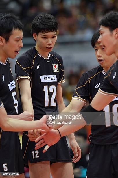 Players of Japan form a huddle during TIME OUT in the match against Tunisia during the FIVB Men's Volleyball World Cup Japan 2015 at the Osaka...