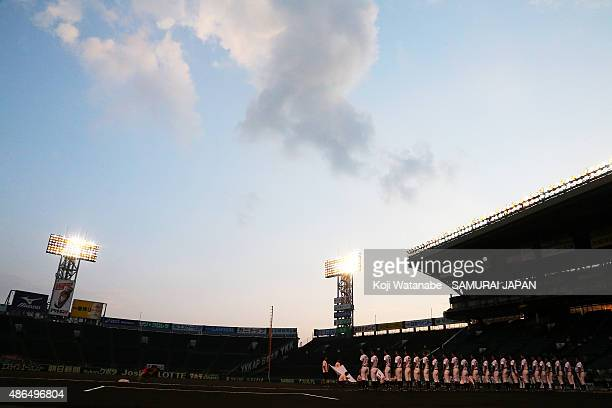 Players of Japan line up for national anthem in the super round game between Japan v South Korea during the 2015 WBSC U18 Baseball World Cup at the...