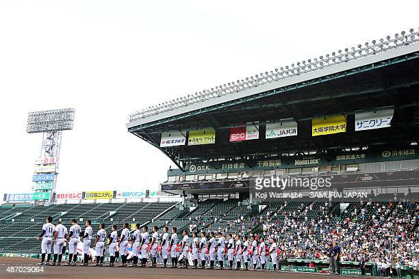 Players of Japan line up for national anthemin the super round game between Japan v Cuba during the 2015 WBSC U18 Baseball World Cup at the Koshien...