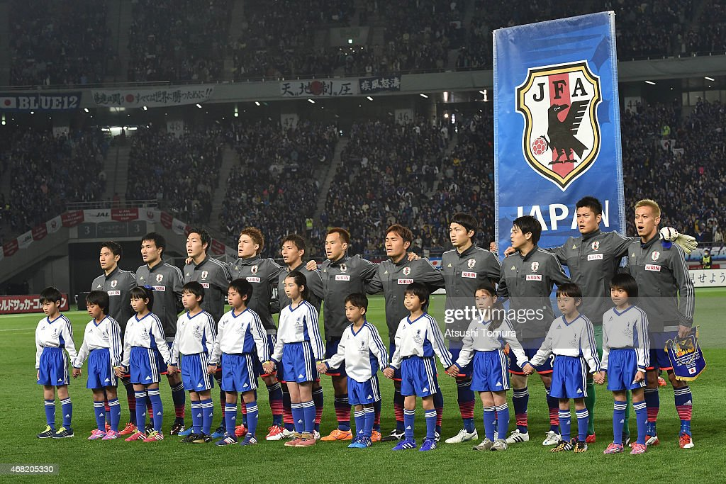 Players of Japan line up prior to the match during the international friendly match between Japan and Uzbekistan at Ajinomoto Stadium on March 31...