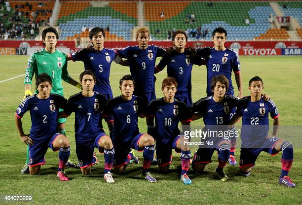Players of Japan pose for a team picture prior to the start of the AFC U22 Championship quarter final match between Iraq and Japan at Seeb Sports...