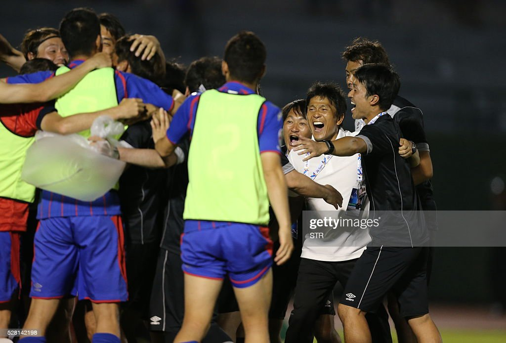 Players of Japan's FC Tokyo celebrate after scoring a goal against Vietnam's Becamex Binh Duong during a AFC Championship Group E football match on May 4, 2016 in Thu Dau Mot city, southern province of Binh Duong. FC Tokyo won 2-1. / AFP / STR