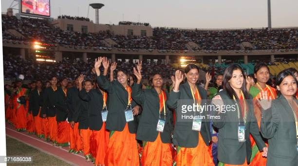 Players of Jharkhand take part in the march past during the inaugural function of 34th National Game at Birsa Munda Athletic Stadium Hotwar in Ranchi