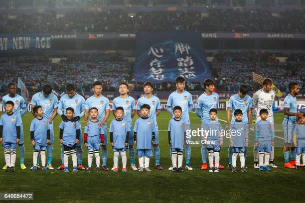 Players of Jiangsu Suning line up prior to the AFC Champions League 2017 Group H match between Jiangsu Suning and Adelaide United at Nanjing Olympic...