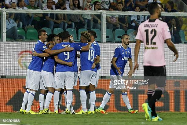 Players of Juventus celebrate after scoring the winning goal during the Serie A match between US Citta di Palermo and Juventus FC at Stadio Renzo...