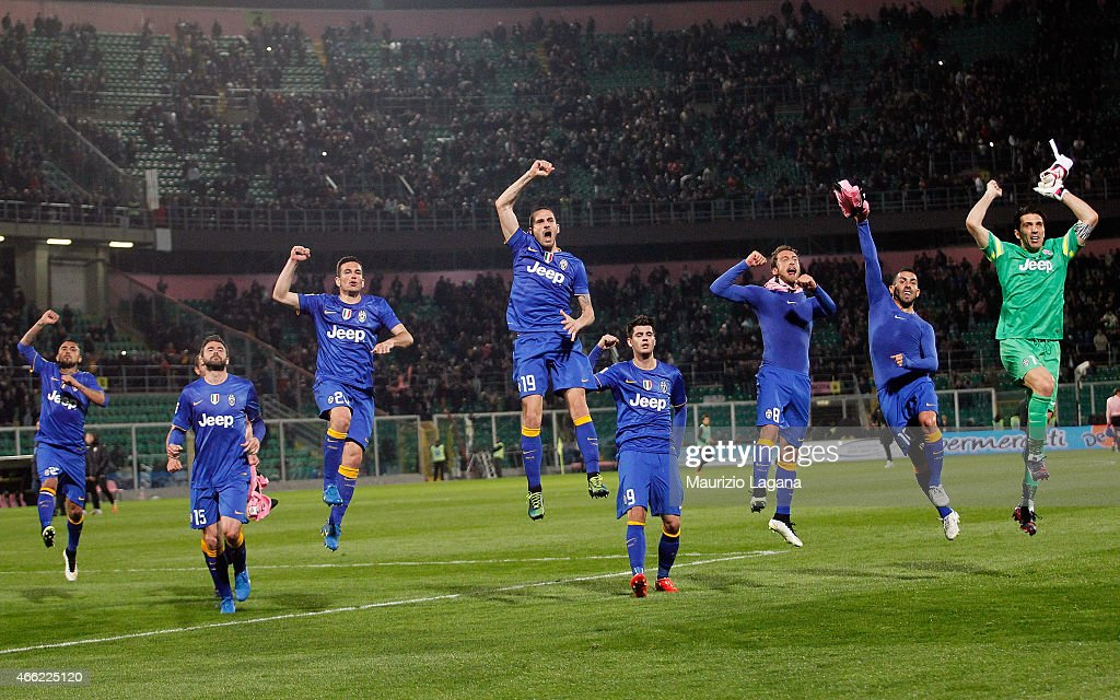 Players of Juventus celebrate after the Serie A match between US Citta di Palermo and Juventus FC at Stadio Renzo Barbera on March 14 2015 in Palermo...