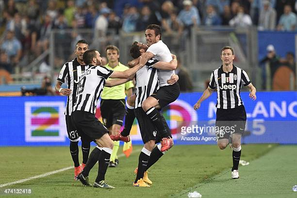 Players of Juventus celebrate scoring during the TIM Cup final match between SS Lazio and Juventus FC at Olimpico Stadium on May 20 2015 in Rome Italy