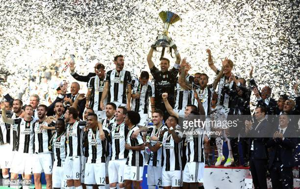 Players of Juventus celebrate the Italian Serie A championship with the trophy after winning the Italian Serie A soccer match between Juventus FC and...