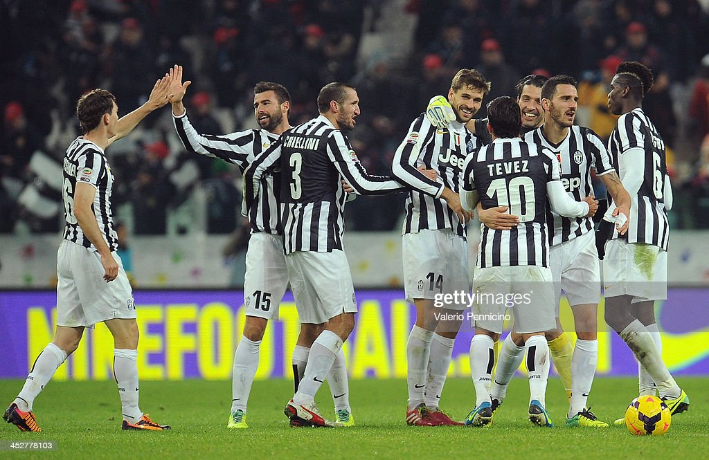 Players of Juventus celebrate victory at the end of the Serie A match between Juventus and Udinese Calcio at Juventus Arena on December 1, 2013 in Turin, Italy.