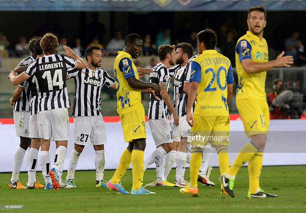 players of Juventus celebrates scoring a goal during the Serie A match between AC Chievo Verona and Juventus at Stadio Marc'Antonio Bentegodi on September 25, 2013 in Verona, Italy.