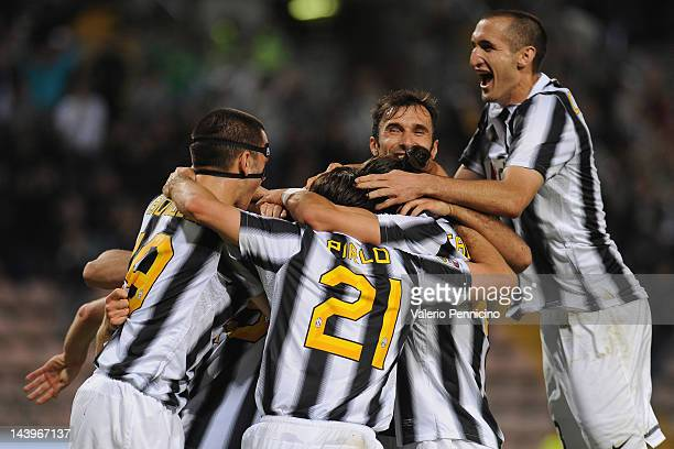 Players of Juventus FC celebrate after beating Cagliari Calcio 20 to win the Serie A Championships during the Serie A match between Cagliari Calcio...